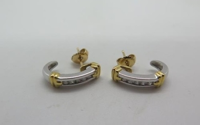 A pair of 18ct yellow and white gold banded diamond earrings...