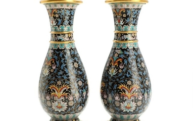 A pair of Chinese cloisonné enamel vases, decorated in colours with flowers and foliage. 20th century. H. 23 cm. (2)