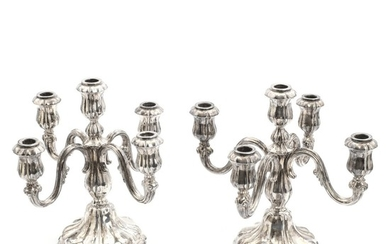A pair of Danish 20th century silver candelabras each with five branches. No maker's mark, 1944. Filled. H. 27.5 cm. (2)