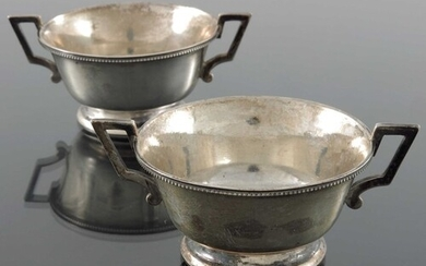 A pair of Victorian silver twin handled bowls, Martin, Hall ...