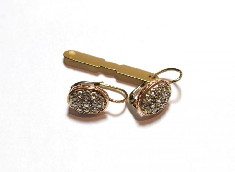 A pair of diamond cluster earrings, the oval plaque set...