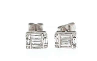 A pair of diamond ear studs each set with numerous brilliant and baguette-cut diamonds weighing a total of app. 0.67 ct., mounted in 18k white gold. (2)