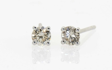 A pair of stud earrings with brilliant cut diamonds