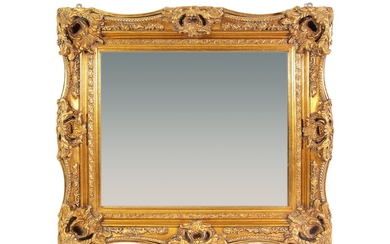 A pastiglia and giltwood mirror