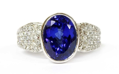 A white gold single stone tanzanite ring