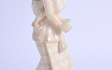 AN EARLY 20TH CENTURY INDIAN CARVED IVORY FIGURE