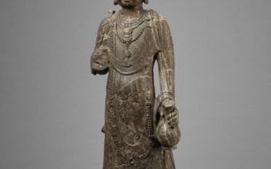 AN EXCEPTIONAL LARGE LIMESTONE FIGURE OF A BODHISATTVA,...