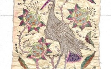 An Early 20th Century Indian Embroidered Panel, worked on cream...