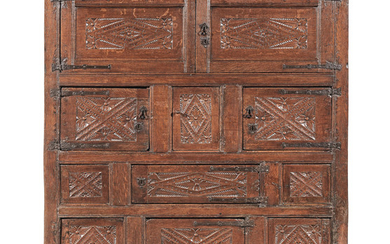 An exceptional and rare Henry VIII joined oak standing 'Great Hall' cupboard, circa 1540