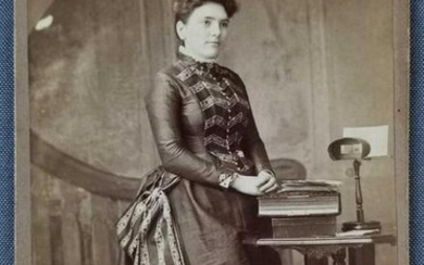 Antique photograph of woman with stereoscope