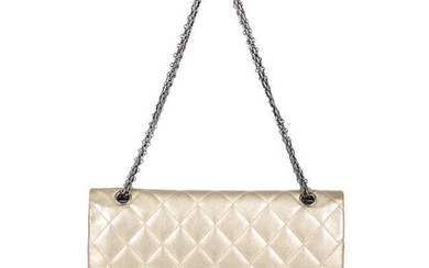 CHANEL - a metallic gold quilted 2.55 Reissue Flap 227 handbag.