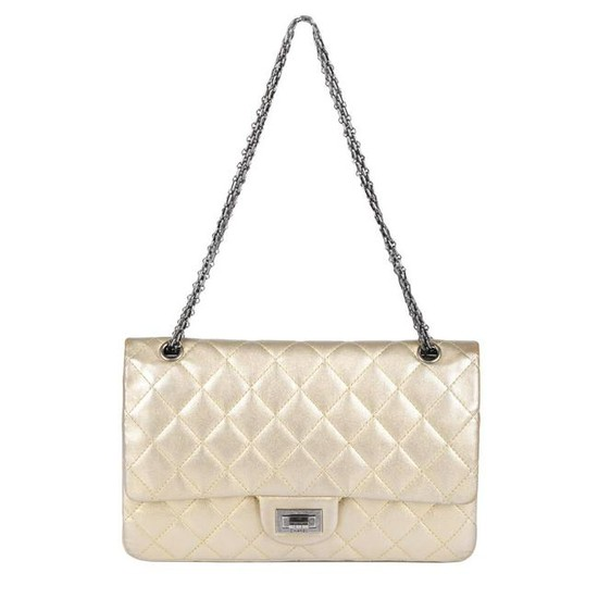 CHANEL - a metallic gold quilted 2.55 Reissue Flap 227