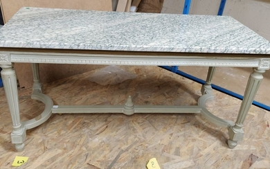 Carved, moulded and painted wood coffee table. Roughened...