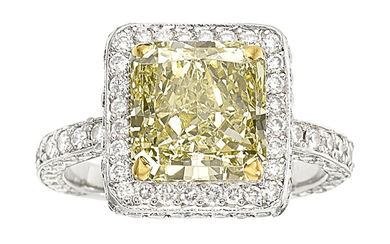 Diamond, Platinum, Gold Ring The ring features a cut-cornered...
