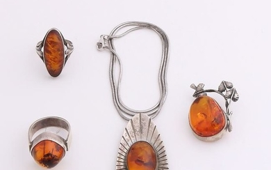 Four silver jewelry with amber. a snake necklace with a