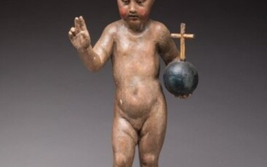 "ITALIAN School of the XVIIIth century Blessed Child Jesus Carved polychrome wood on a base decorated with a cushion and three winged putti heads. Handwritten label on the back: ""Sculpted by (?) after the print of Martin Schaungauer, German artist..."