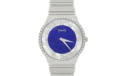 PIAGET | A WHITE GOLD AND DIAMOND SET BRACELET WATCH WITH LAPIS LAZULI AND MOTHER OF PEARL DIAL CIRCA 1980