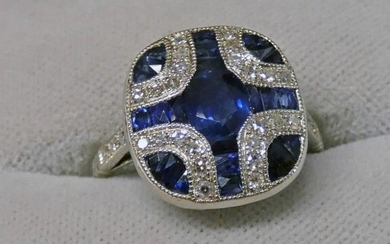 SAPPHIRE & DIAMOND SET RING, THE CENTRALLY OVAL SAPPHIRE...