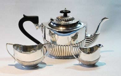 Silver composite three-piece tea set, oval fluted, Chester 1...