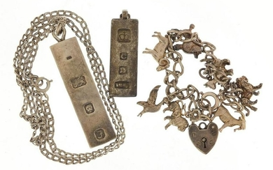 Silver jewellery comprising two pendants, charm