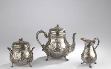 Silver tea service with rocaille decoration, a moving cartouche presenting a figure, including a teapot, a sugar bowl and a pourer Minerve