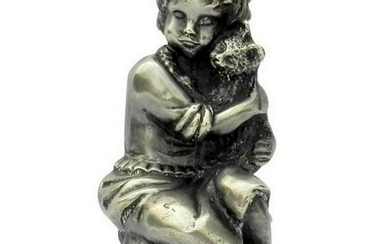 Vintage sculpture of a girl with a cat in her hands