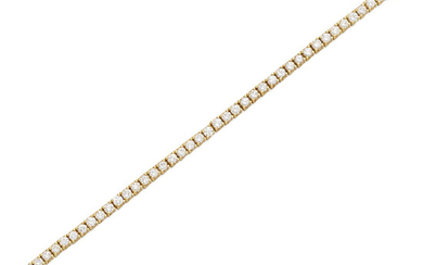 a gold and diamond line bracelet
