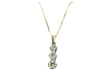 A DIAMOND THREE STONE PENDANT ON CHAIN