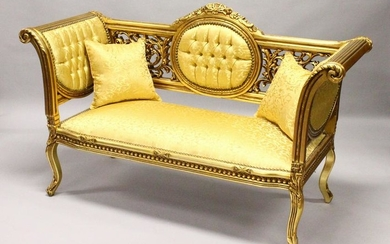 A FRENCH STYLE GILTWOOD SOFA, upholstered in a