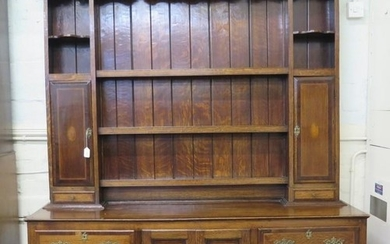 A George III cross and chevron banded oak dresser and rack, ...