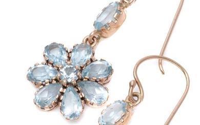 A PAIR OF TOPAZ DAISY CLUSTER EARRINGS; round and pear cut light blue topaz clusters suspended from oval cut topaz on 9ct rose gold...