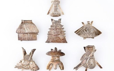 A SET OF TEN CHINESE SILVER PLACE CARD HOLDERS, each