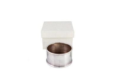 A STERLING SILVER WINE COASTER.