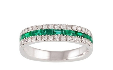 A THREE ROWED DIAMOND AND EMERALD HALF ETERNITY RING, set wi...