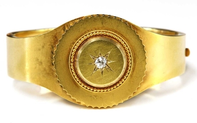 A Victorian gold shield form diamond set hinged bangle, c.1860