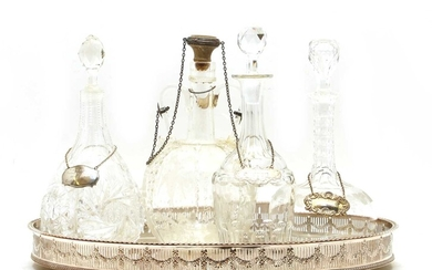 A collection of four cut glass decanters