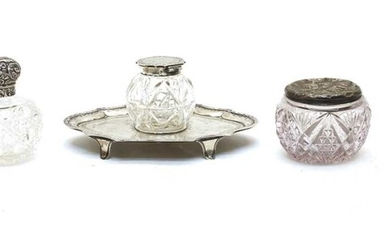 A collection of glass and silver mounted dressing table items