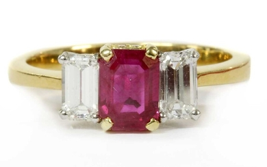 A gold ruby and diamond three stone ring