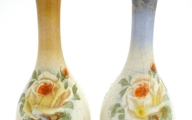 A matched pair of English bottle vases with floral rose