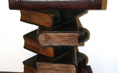A painted and carved wooden pile of books wine table, H. 50cm.