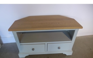 A painted corner TV unit with an oak top