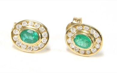 A pair of 9ct gold emerald and diamond cluster earrings