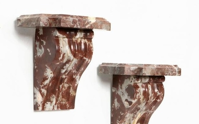 A pair of Neoclassical style marble wall brackets