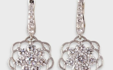 A pair of diamond and platinum drop earrings