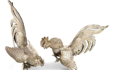 A pair of modern silver fighting cocks, with import marks for London 1963, importer~s mark of I. Freeman and Son Limited, textured feathers with silver-gilt highlights, length 15.5cm, height 13.5cm, approx. weight 7.3oz. (2)