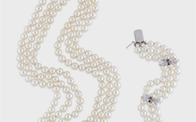 A pearl, sapphire, and fourteen karat white gold necklace...