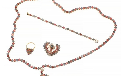 A ruby and sapphire jewellery collection comprising a necklace, a bracelet, two brooches and a ring each set with numerous rubies and sapphire, mounted in silve