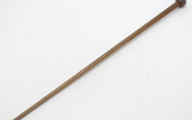 An early 20thC walking stick / cane with a trench art
