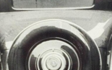 Black and White Photo of a vintage car tire