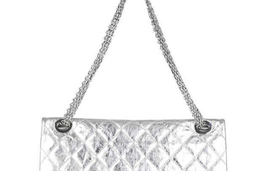 CHANEL - a metallic silver quilted 2.55 Reissue Flap 228 handbag.
